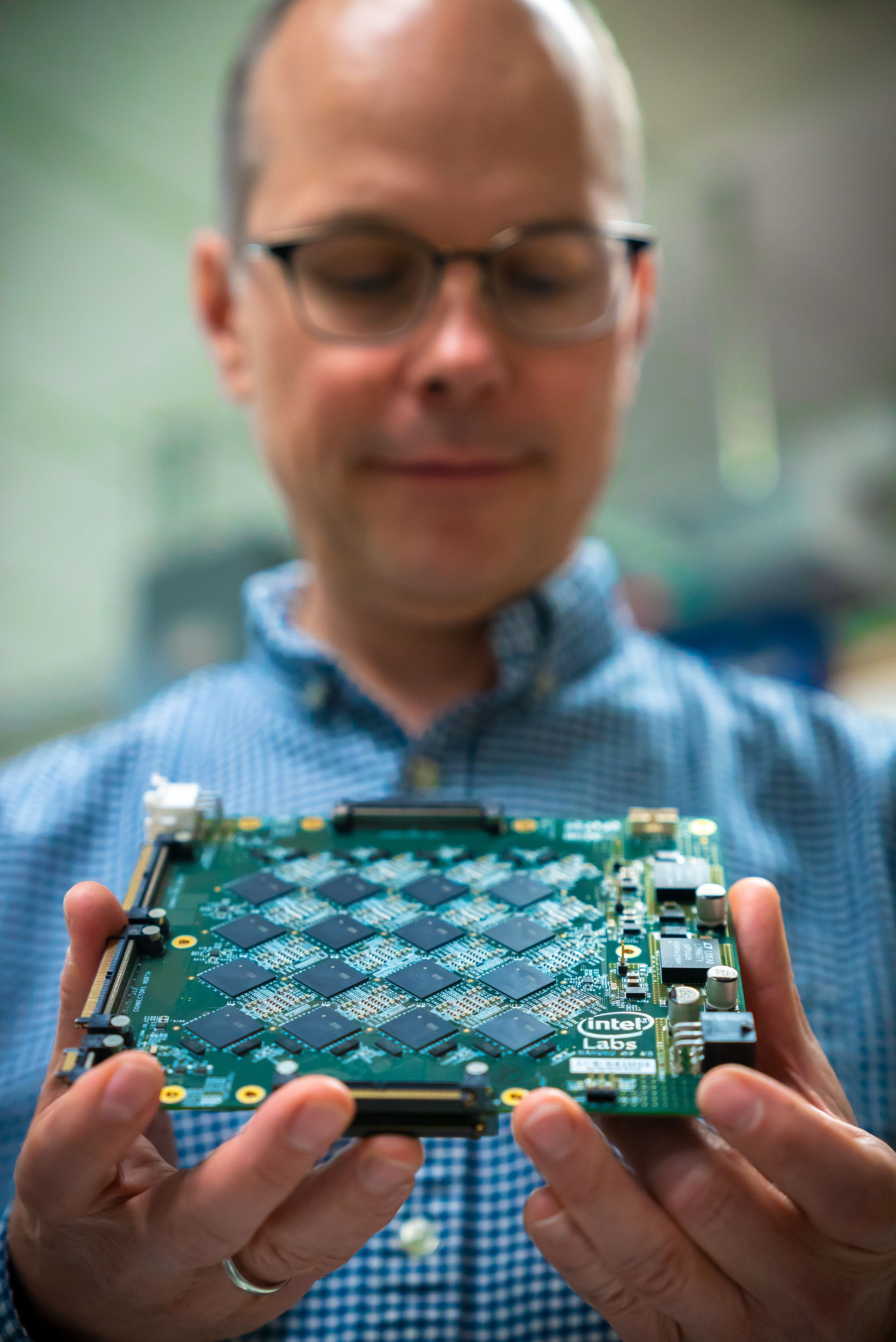 Rich Uhlig, managing director of Intel Labs, holds one of Intel's Nahuku boards, each of which contains 8 to 32 Intel Loihi neuromorphic chips. (Photo credit: Intel)